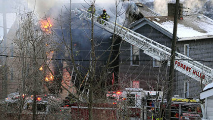 Fireman battle a fire near the intersection of Rebecca Avenue and Thirteenth Street in North Braddock where Three-year-old twins died.