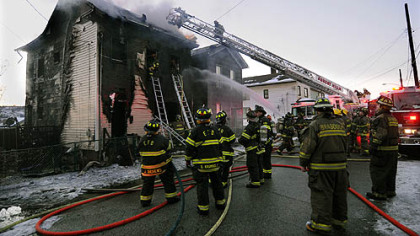 Fireman from numerous companies battle a fire on Rebecca Ave. in North Braddock where infant twin boys died.