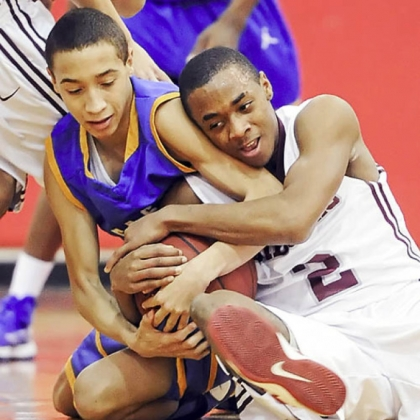East Allegheny's Jordan Williams fights for a loose ball against Ambridge's Stephon McGinnis.