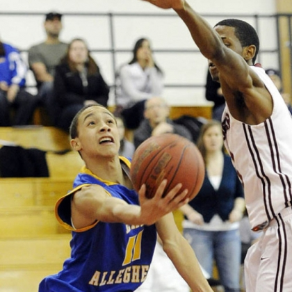 East Allegheny's Jordan Williams scoops up a shot against Ambridge's Khalil Tookes.