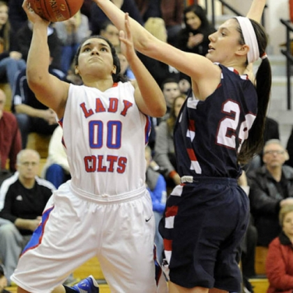 Chartiers Valley High School's Mariah Wells has her shot blocked by Shaler's Andrea Lydon in a girls basketball game Friday night.