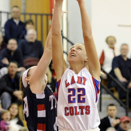 Chartiers Valley's Kristina Coyne reaches for a rebound against Shaler's Abby Conrad.