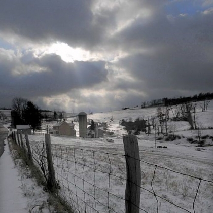 The sun peeks out over a farm scene along Davis School Road in South Strabane, Washington County.