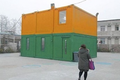 Steel shipping containers have been recycled and stacked for use as rooms at a community center on the outskirts of Beijing. The children of migrants have a place to play or do homework until their parents return from work.