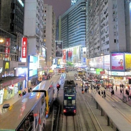 "Double-decker buses move through Hong Kong's vibrant ""Times Square"" district. Although under the sovereignty of the People's Republic of China, the former British colony is allowed to maintain competitive elections, political parties and free enterprise."