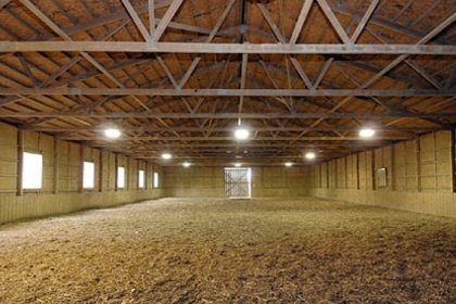 The property includes an indoor riding arena.