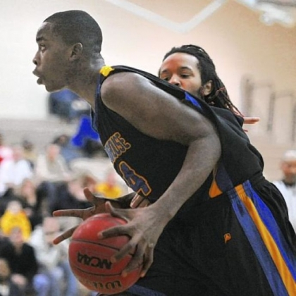 Westinghouse's Affani Brown drives to the basket against Brashear during a City League semifinal game.
