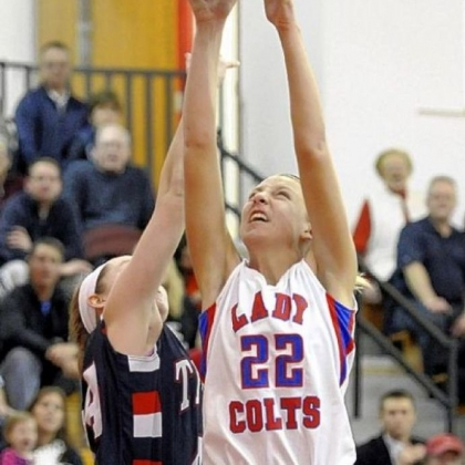 Char Valley's Kristina Coyne reaches for a rebound against Shaler's Abby Conrad.