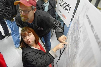 John and MaryBeth Sinagoga of Imperial in Findlay, look over a map of proposed well sites during an open house Monday, sponsored by the Allegheny County Airport Authority and Consol Energy to discuss proposed Marcellus Shale gas drilling at Pittsburgh International Airport. The county approved the plan Tuesday.