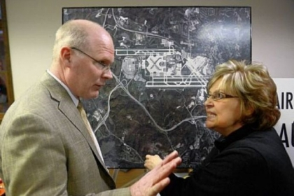 Andrea Fiedler, right, of Imperial in Findlay, questions Randy Forister, senior director of development for the Allegheny County Airport Authority, at an open house in Findlay on Monday, sponsored by the authority and Consol Energy to discuss gas drilling at Pittsburgh International Airport. The county approved a contract with Consol to drill at the airport Tuesday.