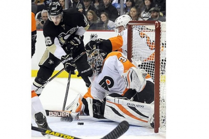 The Penguins' Brandon Sutter scores the tying goal against Flyers goaltender Ilya Bryzgalov in the third period at Consol Energy Center Wednesday night.