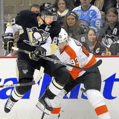The Penguins' Sidney Crosby works the pucks along the boards against the Flyers' Jakub Voracek in the first period  Wednesday night at Consol Energy Center.