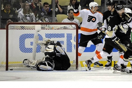 Penguins goaltender Tomas Vokoun dives for the winning goal by the Flyers' Jakub Voracek in the third period at Consol Energy Center Wednesday night.