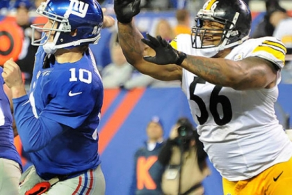 Steelers outside linebacker LaMarr Woodley knocks ball out of Giants quarterback Eli Mannings hands during a game last season.