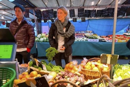 Sewickley native Kristen Beddard (right) of The Kale Project at a market in Paris.