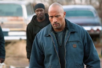Michael Williams and Dwayne Johnson star in &quot;Snitch.&quot;