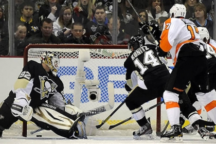 Philadelphia's Wayne Simmonds scores in Wednesday's game on Penguins goaltender Tomas Vokoun. Will the home losing woes be cured in time for tonight's visit by Florida?