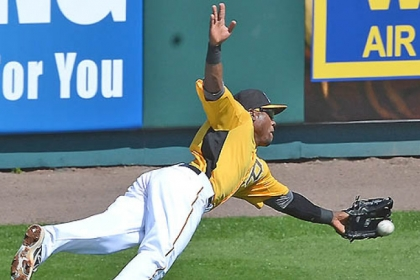 The Pirates&#039; Starling Marte stretches out for a ball during the Pirates&#039; Black and Gold game this afternoon at McKechnie Field in Bradenton, Fla.