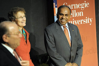 CMU president Jared Cohon, left, jokes with president-elect Subra Suresh, right, as Mr. Suresh makes his first public visit to the university on Thursday with his family, including his wife, Mary, center.