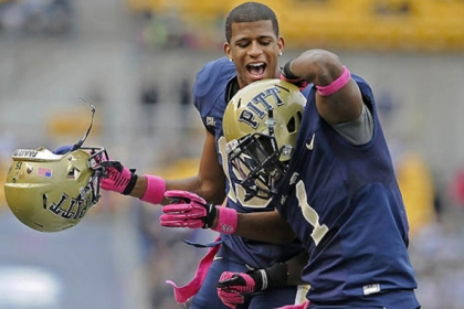 Former Pitt star Ray Graham is congratulated by Devin Street after scoring a touchdown against Temple for the Panthers last season.
