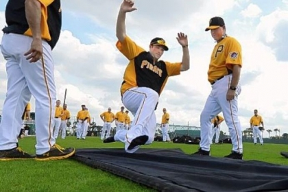 Pirates second baseman Neil Walker goes hard into the sliding mat during workouts Friday at Pirate City in Bradenton, Fla.