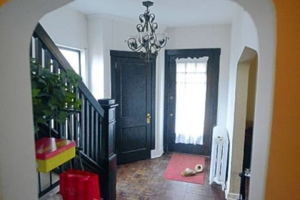 A full-view front door leads to a 13- by 8-foot entry with dark parquet floors.