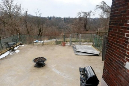 The patio provides views of the hills and valleys below.
