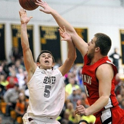 Kittanning's Vince Mead blocks the shot of Beaver's Austin Logan Friday. Logan finished with 36 points in Beaver's 71-66 victory.