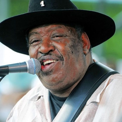 In this July 5, 2009, file photo, Bluesman Magic Slim performs with his band the Teardrops on the final day of the Waterfront Blues Festival in Portland, Ore.