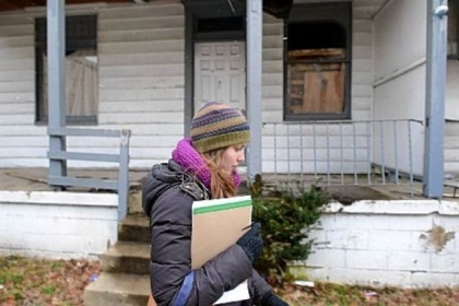 Marlee Gallagher of Wilkinsburg walks along Wallace Avenue trying to collect signatures on a petition to put the liquor license question on the ballot in the dry borough.