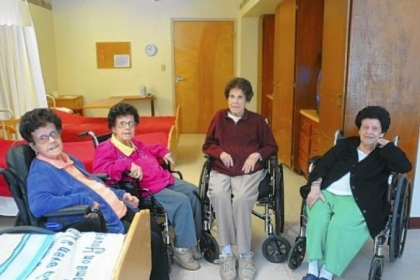 In this Feb. 7 photo, the four Foran sisters, from left, Marie, 86, her twin sister Dolores, 86, Rita, 93, and Helen, 91 pose in the Golden Living Center-York Terrace nursing home in Pottsville, Pa.