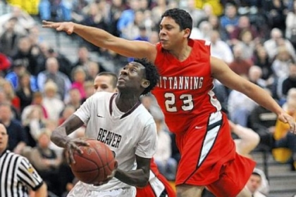 Beaver forward Corey Nesmith scores against Kittanning's Kevin Barnes in the first half Friday.