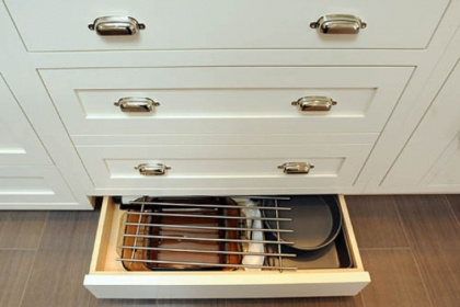 Kick-plate drawers along the floor open at the touch of a hand or toe.