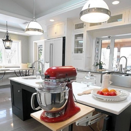 Allison's cherry red KitchenAid mixer swings up on a floating shelf from underneath a counter.