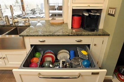 The dishwasher is a drawer among the cabinets in the new Pileggi kitchen. The coffeemaker slides out from its hiding place in a counter-level cabinet.
