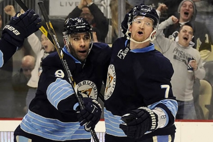 The Penguins' Pascal Dupuis congratulates Paul Martin on a goal against the Lightning in the first period at Consol Energy Center.