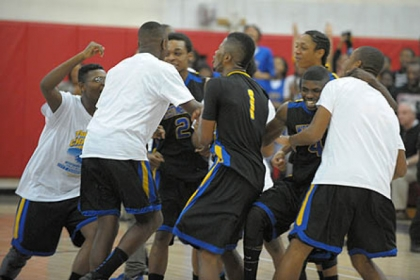 Members of the Westinghouse basketball program celebrate the Bulldogs' victory against Perry for the City League title at Obama Academy High School -- their first City League championship since 1998.
