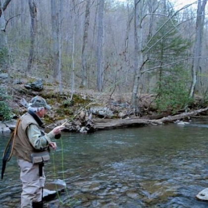 A fisherman is fly fishing for trout on Dunbar Creek in Fayette County.