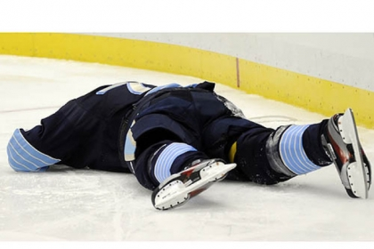 The Penguins&#039; Evgeni Malkin lays on the ice after Panthers defenseman Erik Gudbranson knocked him into the boards in the third period at Consol Energy Center Friday night.
