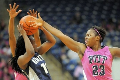 Pitt's Ashlee Anderson, right, tries to get the ball away from Georgetown's Sugar Rodgers Saturday at Petersen Events Center. The Panthers lost, 72-70, when the Hoyas converted two free throws with less than a second remaining.