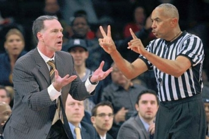 Pitt coach Jamie Dixon, right, reacts to a call by official Tony Greene in the second half.
