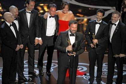 """Argo"" director Ben Affleck, center, accepts the Oscar for best picture at the 85th Annual Academy Awards held Sunday night at the Dolby Theater."