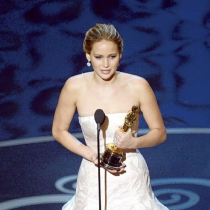 "Jennifer Lawrence accepts the best actress award for her role in ""Silver Linings Playbook."""