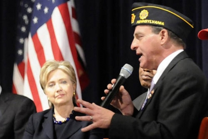 Sen. Hillary Clinton listens as Monroeville mayor and Army veteran Gregory Erosenko talks to a crowd in 2008 at Hopewell High School.