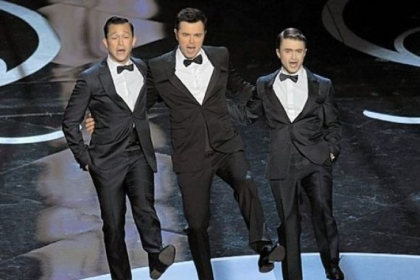 Joseph Gordon-Levitt, host Seth MacFarlane and Daniel Radcliffe perform a dance number at Sunday night&#039;s Oscar ceremony.