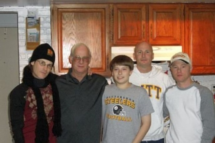 Clark Compston, 74, died at the Pittsburgh VA's University Drive hospital Nov. 14, 2011, after contracting Legionnaires' disease. Mr. Compston, second from left, is seen here with three of his sons and his grandson.