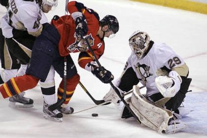The Panthers' Tomas Kopecky looks for the puck as Penguins goalie Marc-Andre Fleury defends during the second period.