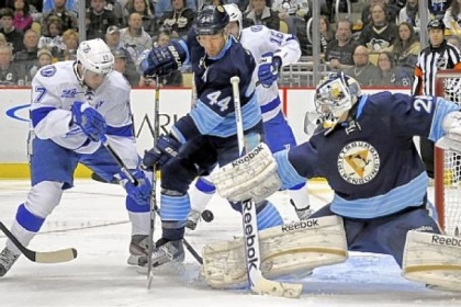 Marc-Andre Fleury stops a shot by Tampa Bay&#039;s Alexander Killorn as Brooks Orpik defends in the second period Sunday at Consol Energy Center.