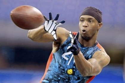 WVU receiver Tavon Austin makes a catch as he runs a drill at the NFL scouting combine in Indianapolis.
