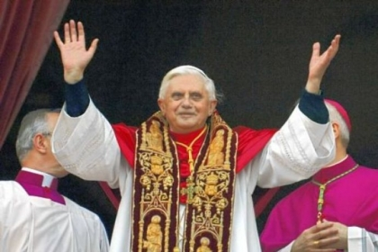 Pope Benedict XVI greets the crowd from the central balcony of St. Peter''s Basilica moments after being elected in 2005.